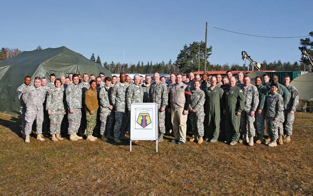 Photos by Spc. Glenn M. AndersonBrig. Gen. Arlan M. DeBlieck (middle left), commanding general of the 7th Civil Support Command, takes a moment with his entire senior staff and joint task force for a photo opportunity during Citizen Response 15 March 9 in Grafenwöhr, Germany.