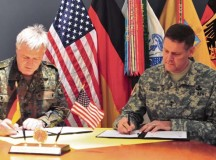 Photo by Ronnie SchelbyMaj. Gen. John O'Connor (right), commander of the 21st Theater Sustainment Command, and Maj. Gen. Hans Erich Antoni, commander of the Bundeswehr Logistics Command, sign a partnership memorandum between the two organizations March 5 on Panzer Kaserne.  This was the first formal renewal of the U.S.-German military logistics partnership in almost 20 years.