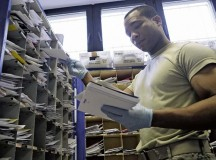 Staff Sgt. James Whyte, 86th Communications Squadron postal specialist, sorts mail in the Northside Post Office Feb. 13.  at Ramstein. The Northside Post Office is the largest Department of Defense postal operation, handling approximately 8 million pounds of mail annually.