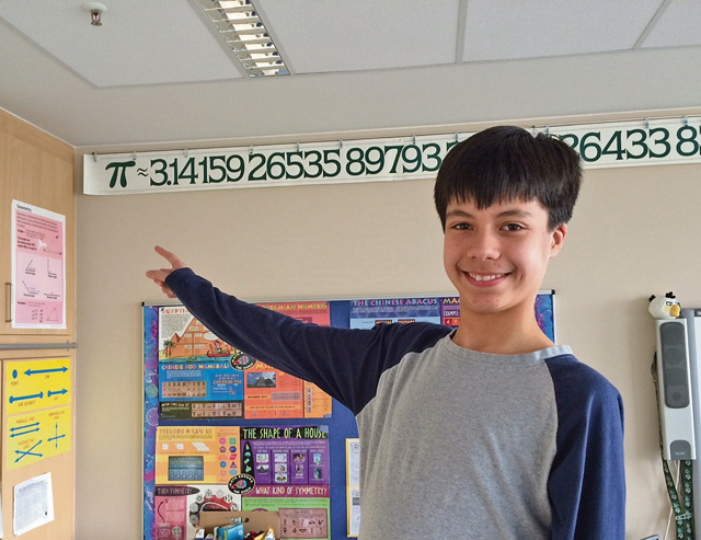 'Courtesy photoEpic Pi DayKaleo Chase is definitely the Pi King1_b@b_1Landstuhl Elementary Middle School. Kaleo recited 84 digits of pi March 14 for Epic Pi Day (Mrs. Stolee-Kiefer's pi sign only goes up to 75 digits). Kaleo has researched the others and is still learning more.' from the web at 'http://www.kaiserslauternamerican.com/wp-content/uploads/2015/03/photo15b1.jpg'