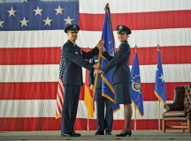 Lt. Gen. Darryl Roberson, 3rd Air Force and 17th Expeditionary Air Force commander, passes the 435th Air Ground Operations Wing's and  435th Air Expeditionary Wing's guidon to Col. Andra Kniep during an assumption of command ceremony March 16 on Ramstein. Kniep has  served on 13 assignments in her Air Force career and most recently served as the 23rd Fighter Wing vice commander at Moody Air Force Base, Georgia.