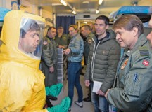 Two Royal Danish air force airmen discuss the aeromedical evacuation unit during a tour they provided to more than 200 aerospace medicine professionals March 11 at Ramstein. The Danish and 18 other nations participated in the 30th Ramstein Aerospace Medicine Summit and NATO Science and Technology Organization Technical Course.