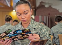 """Staff Sgt. Kathleen Mustafa, 86th Aircraft Maintenance Squadron personnel programs NCO in charge, reads through cards to help determine her personality during a seminar hosted by the """"Let's Connect"""" group."""