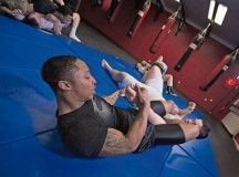 """U.S. Army Spc. Forrest Powell (right), a vehicle mechanic assigned to the 51st Transportation Company, improves his mixed martial arts """"arm-bar.""""  Powell participates in MMA training with German nationals and American citizens in hopes of improving his skills as an MMA fighter."""