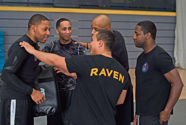 Members of the 86th Security Forces Squadron Raven team discuss the next move they will teach attendees. This team of Ravens took part in the seminar to share their hand-to-hand combat experience with event participants.