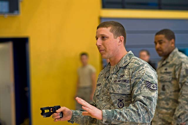 Staff Sgt. Jeffery Fitzgerald, 86th Security Forces Squadron instructor, informs people about Tasers. Attendees of the seminar had the option to experience firsthand the effects of being immobilized by a stun gun.