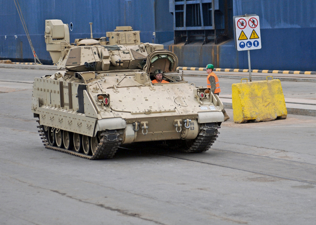 "Photo by Staff Sgt. Warren W. Wright Jr.Soldiers from the 3rd Infantry Division move an M1A2 Abrams Main Battle Tank immediately after its removal from the transportation vessel ""Liberty Promise"" March 9 at the Riga Universal Terminal."