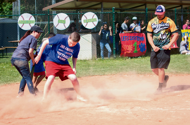 Braden Marler slides into home plate at the Ramstein High School softball field.
