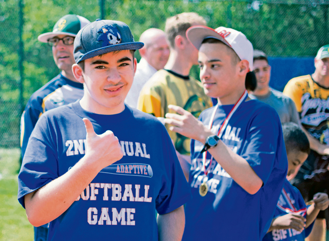 Adam Johnston gives a thumbs-up at the Ramstein High School softball field.