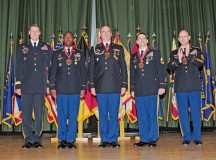 Newly inducted members of the Sergeant Morales Club stand with Maj. Gen. John R. O'Connor (left) and Command Sgt. Maj. Rodney J. Rhoades (right), the commanding general and the senior enlisted leader of the 21st Theater Sustainment Command respectively, during an induction ceremony May 19 on Smith Barracks.