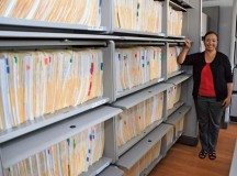 Europe Regional Medical Command Exceptional Family Member Program director Leslie Garcia shows what one year's worth of EFMP family travel requests look like when filed.