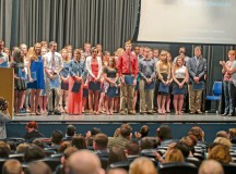 Graduating high school students stand for photos after receiving their scholarships for higher education May 17 on Ramstein.