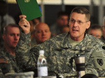 Maj. Gen. John R. O'Connor, commanding general of the 21st Theater Sustainment Command, reads an excerpt explaining the importance of logistics during the 21st TSC hosted table-top exercise May 27.