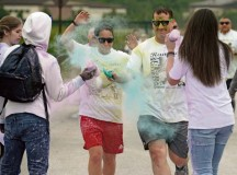 KMC members run through a color station during a color run May 30 on Ramstein. The 5K fun run helped raise funds for the prevention of teen suicide.
