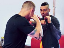 "Dan ""The Outlaw"" Hardy (right), an accomplished veteran of the Ultimate Fighting Championship, demonstrates a movement technique with Staff Sgt. David Maybury, 7th Civil Support Command, 21st Theater Sustainment Command master combatives trainer during a mixed martial arts seminar June 2 on Ramstein."