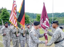 Photo by Phil A. Jones Brig. Gen. Norvell V. Coots (right), Commander for Europe Regional Medical Command and the Command Surgeon for U.S. Army Europe, passes the colors to Col. James Laterza signifying him as the new commander for Landstuhl Regional Medical Center during a change of command ceremony May 29.