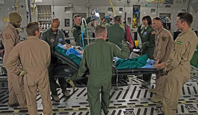 Airmen from the Strategic Airlift Capability Heavy Airlift Wing based at Papa Air Base, Hungary, and Ramstein carry a wounded patient onto a C-17 Globemaster III for transport June 8 in Bulgaria. The patient sustained injuries during a training event and was sent to Landstuhl Regional Medical Center for medical care.