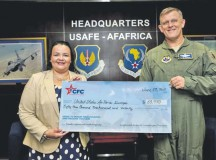Victoria Adams, Combined Federal Campaign-Overseas executive director, presents a check on June 23 to Gen. Frank Gorenc, U.S. Air Forces in Europe and Air Forces Africa commander, for funds raised last year.