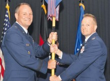 Photo by Staff Sgt. Sharida Jackson Col. Brent Johnson (right), accepts the 86th Medical Group's guidon from 86th Airlift Wing Commander Brig. Gen. Jon Thomas (left), during the 86th MG's change of command ceremony June 30.