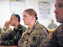 Capt. Karen M. Berggren, the operational law judge advocate for the 18th Multi-National Brigade, listens to an update briefing during Rapid Trident 15 July 30 at the International Peacekeeping and Security Center.