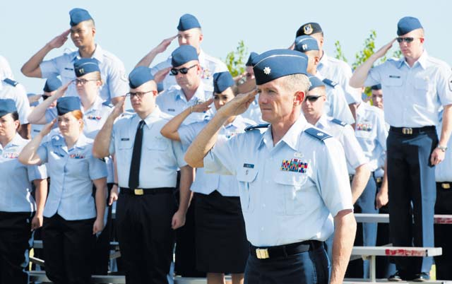 Lt. Col. Brian Belson, deputy commander of the 65th Air Base Group, salutes during the 65th Air Base Wing's redesignation ceremony Aug. 14 on Lajes Field, Azores, Portugal.