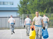 Staff Sgt. Ryan Evans, 721st Aerial Port Squadron passenger services specialist, carries water jugs during the obstacle course at the 2015 Ramstein Air Base Rodeo Aug. 1 on Ramstein. The rodeo is a skills competition and includes numerous events such as forklift operations, center of balance calculations and cargo pallet buildup.