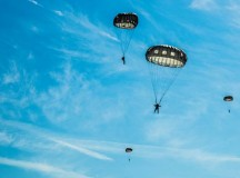 Airmen and Soldiers parachute from an 86th Airlift Wing C-130J Super Hercules over Alzey drop zone Aug. 31 in Germany. More than 20 Air Force independent duty medical technicians, security forces members and Army Special Forces paratroopers descended to the ground to quickly respond to a simulated medical emergency.