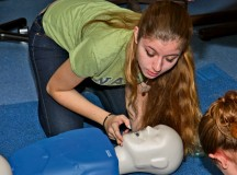 Photos by the 7th Civil Support Command Public Affairs Office Renee Gladu, a candidate in the Certified Nursing Assistant program at Ramstein High School, performs lifesaving procedures on a clinic dummy during training for licensing as a nursing assistant Sept. 13 at RHS.