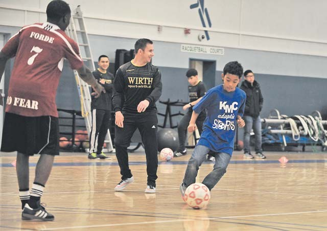 Elijah Muhammad, Ramstein Middle School student, dribbles the ball toward a goal during the KMC Adaptive Sports soccer event Oct. 15 on Vogelweh. Special needs students from Ramstein and Vogelweh middle and high schools had the opportunity to play soccer against each other and build camaraderie.