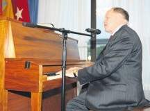 Retired Maj. Gen. Douglas L. Carver, the 22nd Army chief of chaplains, took a turn at the piano before taking to the podium during the Rheinland-Pfalz community prayer breakfast Oct. 21 at the Ramstein Officers' Club.