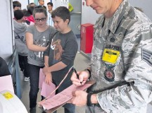 Staff Sgt. David Lund, 86th Civil Engineer Squadron, Civil Engineer Fire Department, mans the blood pressure station while Students at Ramstein Middle School receive their annual health screening. With the assistance of volunteers from numerous organizations within the base medical community, more than 860 students in grades six through eight were seen in three short days. Among the many organizations that provided volunteers were the U.S. Air Forces in Europe Surgeon General, 86th Aerospace Medical Squadron, 86th CES, 86th Aeromedical Evacuation Squadron, 86th Medical Support Squadron, 86th Medical Group and 21st Operational Weather Squadron. These civilians and service members were friendly, helpful, efficient and, above all, patient. Without their support, students could not have received their health screening in such a timely manner.