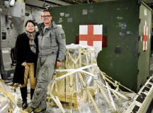 Kasper Chevalier, 721st Aerial Port Squadron aerial porter, shows his wife, Frieda Chevalier, what his day-to-day job on a C-17 Globemaster III entails Oct. 16 on Ramstein. Chevalier completed his 2,000th aerial port expeditor mission during this cargo load.