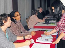 Photo by Ronna Anderson Schelby Kate Dunbar, focus group leader of AFAP Benefits and Entitlements (far left), helps gather issues and signs up volunteers at the Army Family Action Plan town hall event Oct. 22 at Armstrong's Club on Vogelweh.