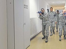 Two students from the Expeditionary Active Shooter Training class, followed by their instructors, search a hallway as they make their way to an exit during an active shooter scenario Nov. 5 on Ramstein. The EAST class is a requirement for deploying Airmen and includes hands-on practical training to further prepare the student for a real active shooter situation.