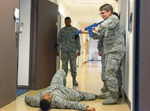 Photo by Airman 1st Class Tryphena Mayhugh A student in the Expeditionary Active Shooter Training class checks on a fallen Airman during a simulated active shooter scenario Nov. 5 on Ramstein. The course is a requirement for deploying Airmen and includes a hands-on practical portion that allows the students to use the skills they were taught in the course.