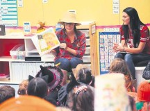 Katherine Sadusky (left) and Kylie Nelson, both second-grade teachers, read books to students during a Fall Harvest Moon Reading night Oct. 27 at Vogelweh Elementary School. Students dressed in costumes, enjoyed a hot dog dinner and listened to books read to them by teacher volunteers. All students received a free book courtesy of VES PTSA.