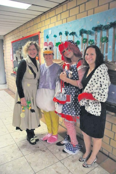(From left) Kelly Scott, first-grade teacher, Kerri Larimer, information specialist, Kristine Cephus, kindergarten teacher, and Amy Hudzikiewicz, first-grade teacher, pose for a photo during a Fall Harvest Moon Reading night at Vogelweh Elementary School.