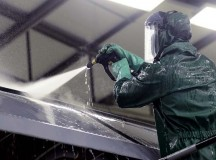 Airman Drew Thurau, 86th Maintenance Squadron crew chief, sprays water on the wing of a Ramstein C-130J Super Hercules during a pre-isochronal inspection wash Jan. 4 on Ramstein. An ISO inspection is a scheduled, extensive examination of an aircraft to maintain its functionality and perform preventive maintenance.