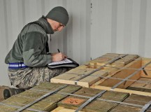 "Senior Airman Nathan Slagle, 86th Munitions Squadron munitions storage crew chief, takes accountability of explosives and checks for vulnerabilities on an artillery delivery Dec. 8 on Ramstein. The 86th MUNS provides ""the lethal edge"" to combatant commands around the world."