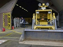 Airmen from the 786th Civil Engineer Squadron Explosive Ordnance Disposal configure their remote computer as they prepare to do maintenance on their All-Purpose Remote Transport System Jan. 28 on Ramstein. The Airmen tested the ARTS on maneuvering through an environment and locating objects scattered around the training area.