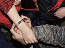 An Airman from the 86th Security Forces Squadron demonstrates how SFS members use handcuffs to a Cub Scout Feb. 3 on Ramstein. Airmen from the 86th SFS gave local Cub Scouts a tour of their facilities and taught them about some of the equipment they could use.