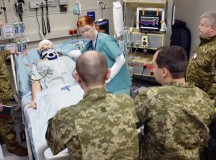 Landstuhl Regional Medical Center registered nurse Amy Lawson demonstrates how an advanced patient simulator is used to train intensive care unit medical personnel to Ukrainian military surgeons 1st Lt. Volodymyr Prytula (far left), Capt. Pavlo Shkliarevych (middle left), Maj. Serhii Shypilov (center) and Lt. Col. Mykola Moskvychov (far right) as LRMC ICU clinical nurse specialist Air Force Lt. Col. Cheryl Lockhart observes Jan. 26. The four Ukrainian surgeons spent a week learning about Army Medicine in Europe at LRMC and with the 212th Combat Support Hospital.