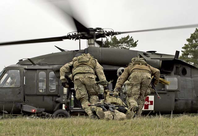 Airmen from the 2nd Air Support Operations Squadron drag a simulated casualty for medical evacuation during training Feb. 8 at U.S. Army Garrison Bavaria in Vilseck, Germany. The training consisted of calling in close air support, neutralizing opposing forces, and practicing medical evacuation by helicopter. Blank rounds and smoke grenades were used during the training to simulate the potential chaos an ASOS Airman may experience during a real-world mission.