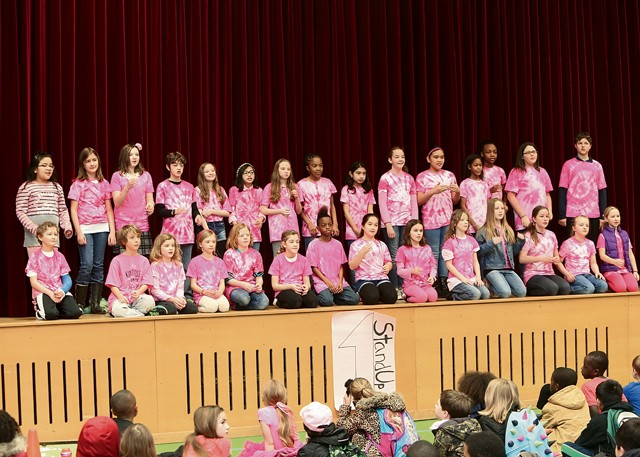 "Photo by Jennifer Barnes The Vogelweh Elementary Student Leadership Club performs a song in sign language during ""Pink Shirt Day"" at Vogelweh Elementary School."