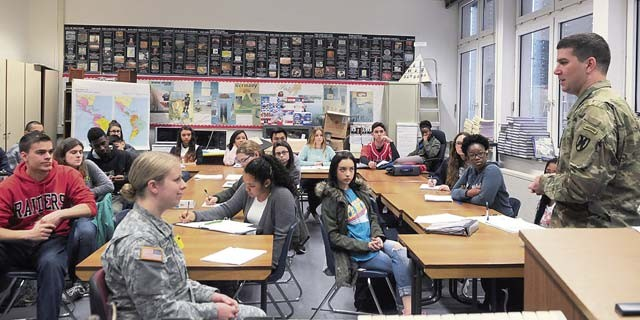 Capt. Jennifer Bromm, trial counsel, and Capt. Matt Montazzoli, administrative law attorney, both of the 21st Theater Sustainment Command, provide legal information to junior and senior students in Mark Fairchild's Street Law class March 25 at Kaiserslautern High School on Vogelweh. These students are preparing for the upcoming mock trial to be held as part of the 21st TSC Law Day celebration on May 2.