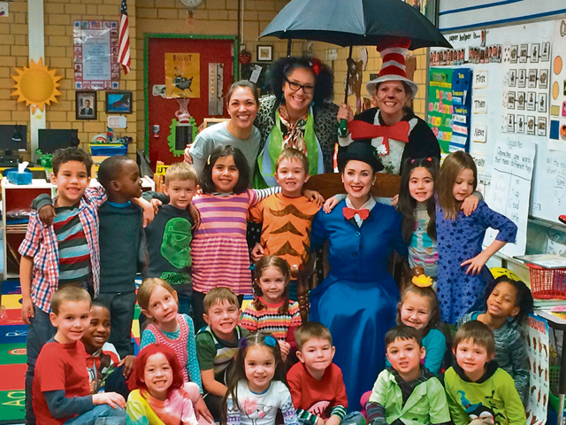 Photo by Makeda CatronLeft photo: Mary Poppins visits Kristine Cephus' kindergarten class March 3 at Vogelweh Elementary School to help celebrate Dr. Seuss' birthday.