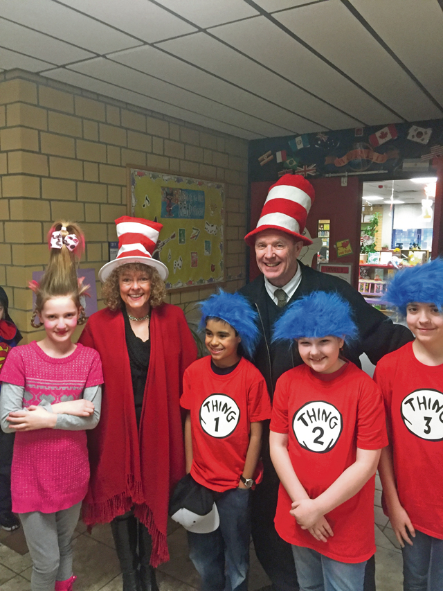 "Photo by Xavier FloresDr. Dell McMullen, Department of Defense Education Activity Europe director, celebrates ""Read Across DODEA Day"" in honor of Dr. Seuss' birthday March 3 with students from Vogelweh Elementary School."