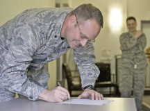Brig. Gen. Jon T. Thomas, 86th Airlift Wing commander, signs a pledge to kick off the 2016 Air Force Assistance Fund campaign March 21 on Ramstein. The program is designed to allow Airmen to help others through the program's charitable affiliates that provide support to Airmen and their dependents, including those in emergencies and those who need help paying for educational costs.