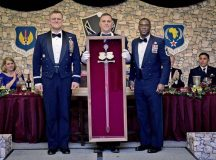 Photos by Tech. Sgt. Ryan CraneGen. Frank Gorenc, U.S. Air Forces in Europe and Air Forces Africa commander, is presented his personal sword by Command Chiefs Samuel Simmons (center) and James Davis (right) during an Order of the Sword ceremony April 7 on Ramstein. The Order of the Sword is a special program where noncommissioned officers of a command recognize individuals who have made significant contributions to the enlisted corps. Gorenc is the 20th USAFE-AFAFRICA commander to be awarded this honor.