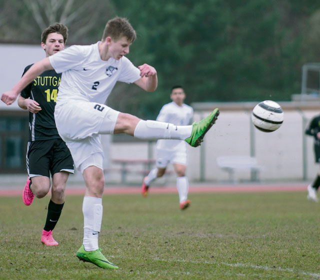 C.J. Klawitter, sophomore at Ramstein High School, strikes the ball during a game against Stuttgart High School March 26 at RHS.